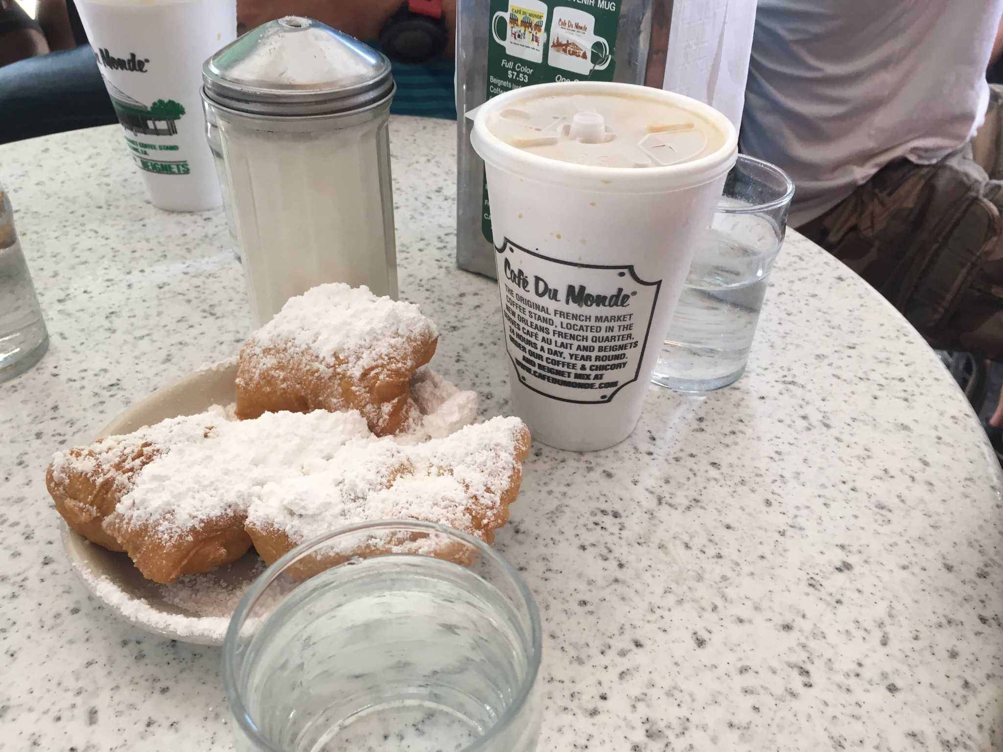 BEIGNETS AND COFFEE: Try Cafe au Lait with the beignets at Cafe du Monde — that's a delicious pair!