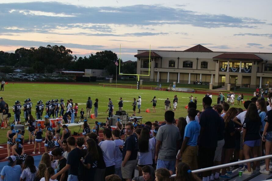 Students+of+all+grades+packed+the+stands+for+the+football+game%21