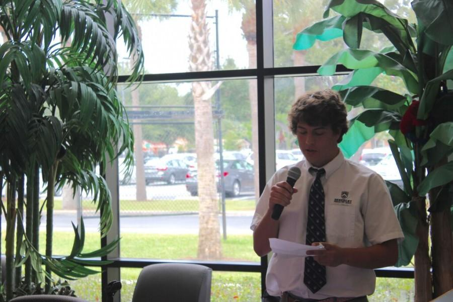 Riley Graham '16 reads a poem from his English class about when he was ill.