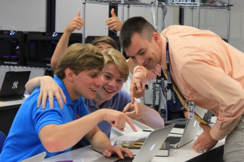 Mr. Smith makes AP Computer Science come alive, and seniors Lance Esposito (left), Boone Fisher (right), and Robert Baldy (background) are loving their new teacher. Additionally, Mr. Smith worked in the Navy for 11 years, spending much of his time working with the NSA.