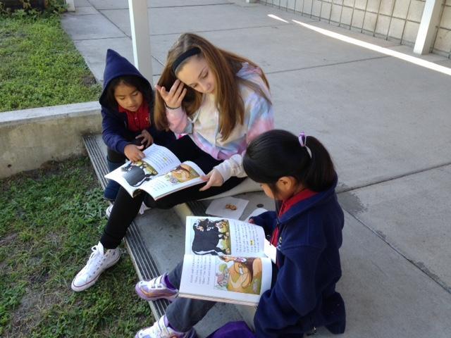 Students at RCMA enjoyed reading books with Berkeley ninth graders.