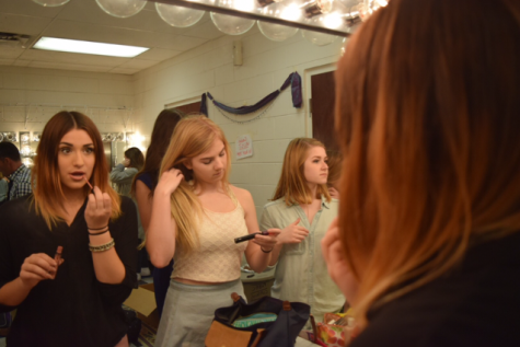 Cast members get ready for the show.