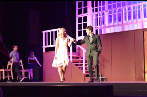 Elle Woods and Warner Huntington III are seen onstage together.