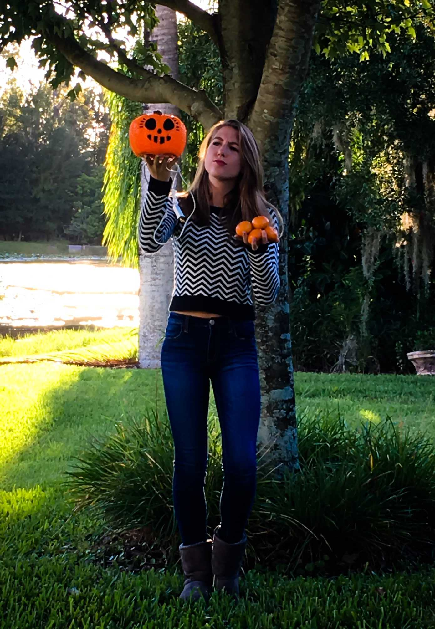 NOT-SO SWEATER WEATHER: I have my sweater and boots on, I've clicked my heels three times, I don't understand what else it's going to take to turn my fake Jack-O-Lantern into a real autumn treat. These oranges don't fill my fall- deprived heart like a pumpkin would.