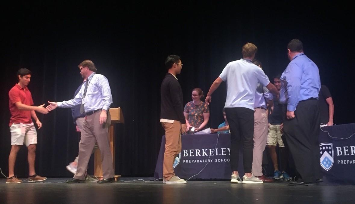 COMPETITORS CALL IT A DAY: After a nail biting experience watching the final showdown, students were relieved to see the two teams in the finals shake hands. This year's Fall Trivia Tournament was especially exciting, as an intrigued audience watched Mr. Gregg and Mr. Smith fire answers back and forth for the win.