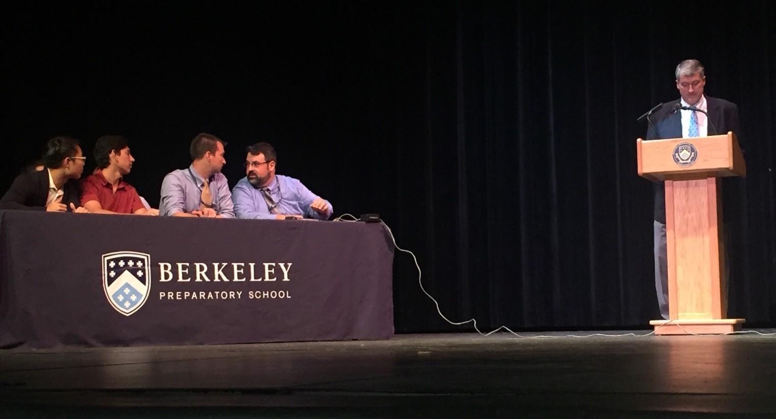 DYNAMIC DUO: Though the student competitors showed their trivia talent during Monday's tournament, all eyes were on the teachers as they fired answers across the stage. Mr. Smith and Mr. Jacobs conversed throughout the tournament, double checking and congratulating each other on answers.