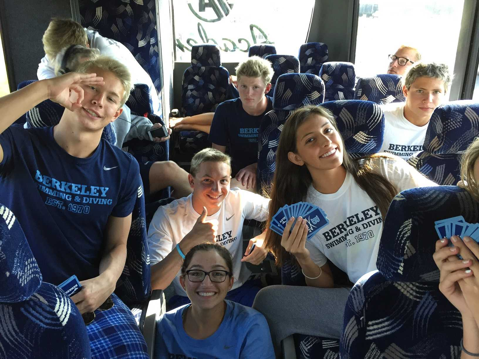 WHEELS ON THE BUS: One of the wheels on the bus back from regionals caught a flat, leaving the Bucs stranded on the side of the road. Luckily, the swimmers had cards to entertain them while they waited. Pictured above is Robert Cecil '17, Arielle Bader '17, Nathan Stovern '17, Scott Showalter '21, Sabrina Vergara '19, Daryl Pickerell '17 and Ryaan Hatoum '19 (from left).