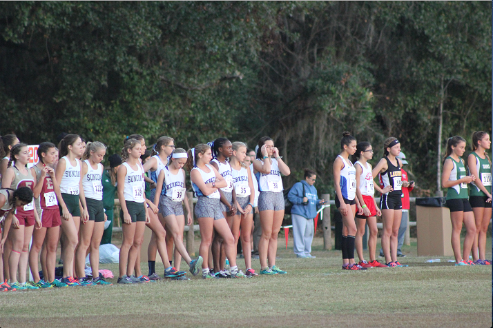 READY FOR ACTION: The girls' team stands on the start line anxiously awaiting the start instructions to be issued.