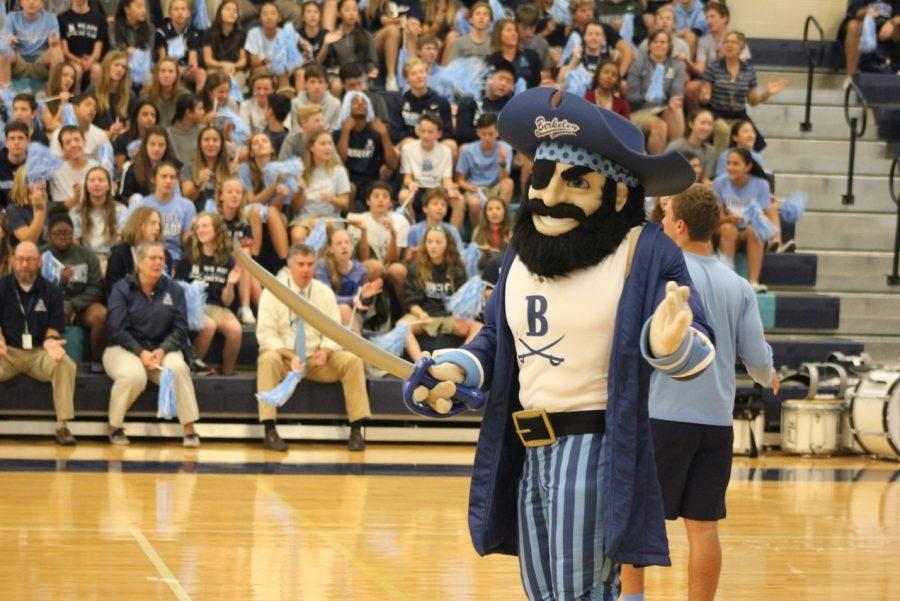 LET'S GO BUCS: Bucky surprises the crowd at all school convo to help them get off their feet and cheer. At this all-school convo Richard Shao '19 was the man inside the Bucky costume.