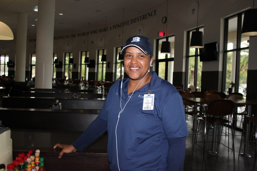 """MUSIC GETS US THROUGH THE DAY: Sara Villanueva listens to music while working. """"I mostly listen to R&B,"""" she says before moving on, stopping to smile at students and teachers as they pass in for a morning meal."""