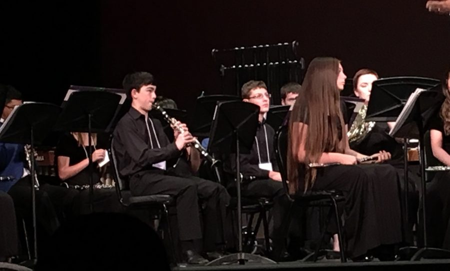 HITTING THE RIGHT NOTES: Florida's top 9th and 10th grade musicians, including Jalen Li '19, perform Holst's complex and challenging Second Suite.