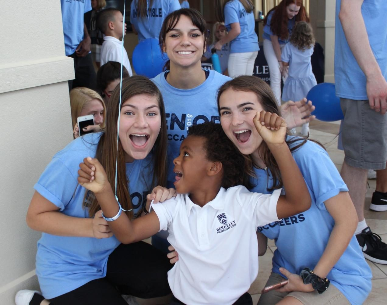 """FUN AND GAMES: Karina Barcenas '18, Natalie Belluccia '18 and Caroline Paskert '18 (from left) enjoyed making funny faces with their buddy, Baylin Moein '30. """"He was so silly! I loved hanging out with him,"""" Barcenas said."""