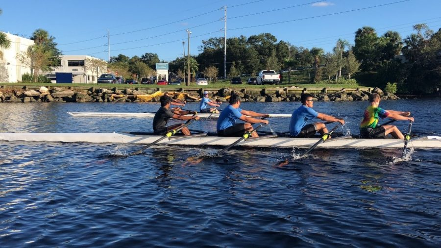 TRAINING FOR THE HOOCH: Dev Kapadia '19, Richard Shao '19, James Koh '20, and Bill van de Groep '20 (left to right) trained for the Head of the Hooch Rowing Competition.