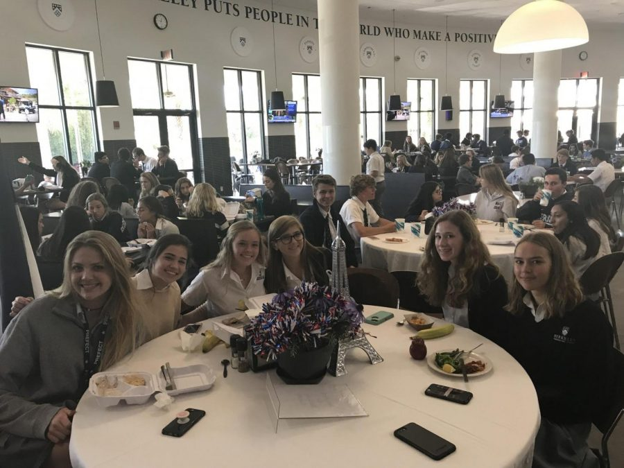 """FRENCH ONLY, PLEASE: From left: Caroline Merrill '18, Cali Governale '20, Marissa Streng '20, Alexis Scarlett '20, Sloane Daley '20, Leila Pyrczak '19 practicing their French at the very first """"La Table Française."""""""