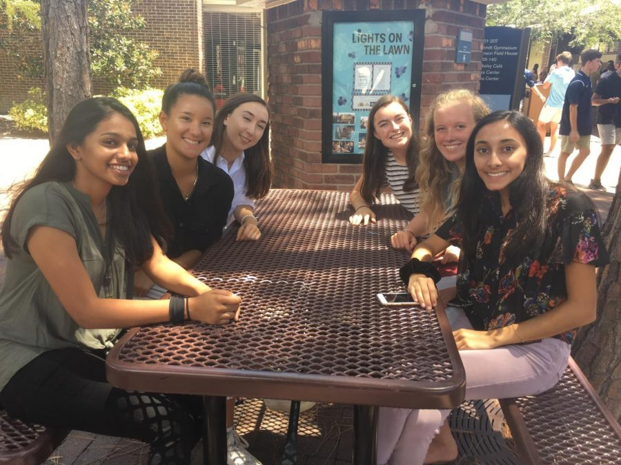 NEW HOME: Sophomores Rani Shete '21, Annaliese Donaldson-Pham '21, Ella Castellano '21, Maddie Sakalosky '21, Amy Wotovich '21, and Riana Amin '21 (from left) gather during break at the kiosk, their new home.