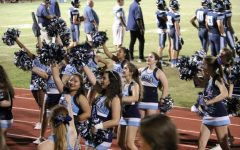 CHEER ON: The Berkeley cheerleaders pump up the crowd for the last football game of the season.