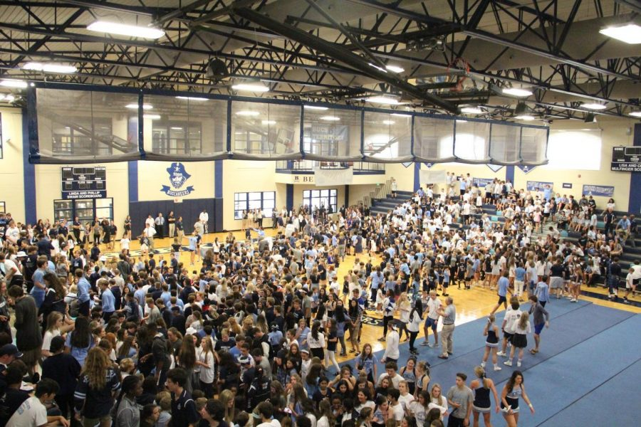 OVER TOO SOON: Students and faculty file out of the Doyle Gymnasium as the pep rally comes to an end.