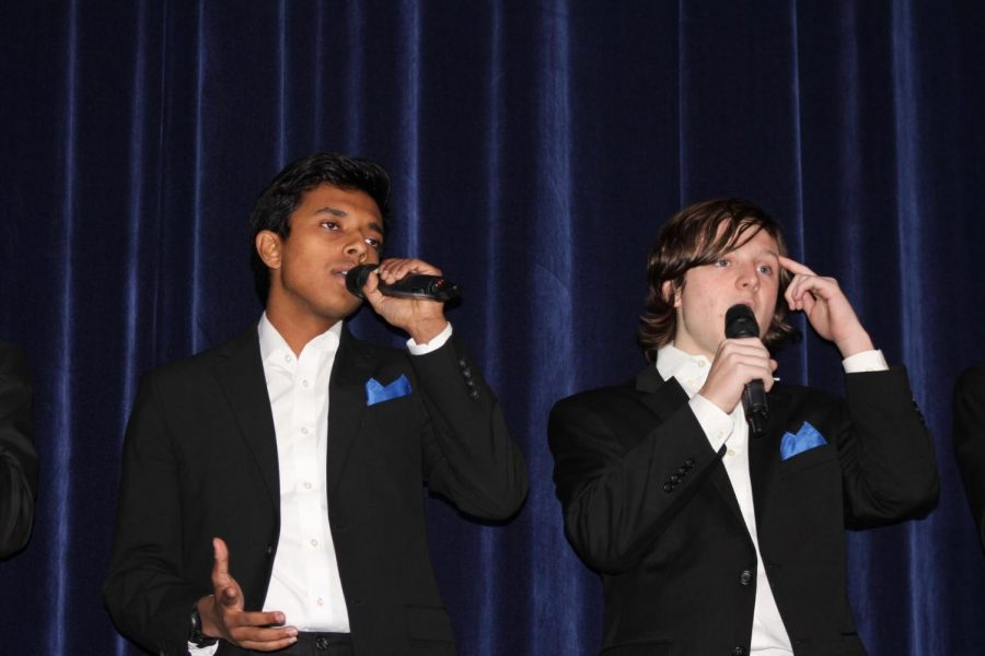 "HOLIDAY TRADITIONS: Beatitones, Riju Datta '20 and Thatcher Crouch '21, gesture and sing ""Rudolph the Red-Nosed Reindeer."" Both members have performed this song in previous years as it is known as a Berkeley holiday staple."