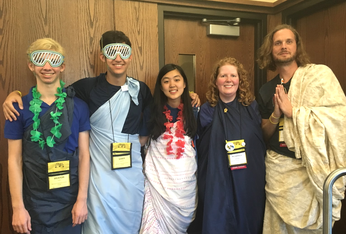 TOGA TIME: Weston Poe '22, Samir Saeed '21, Mara Xiong '20, Sarah McDaniels and Phil Dillinger (from left) dress in their best togas for the Roman Procession on the final day of the NJCL convention.