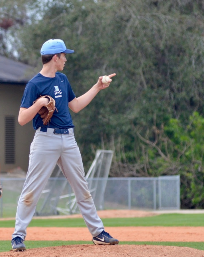 CALLING THE SHOTS: Will Parkinson '21 points to his teammate as he directs the next pitch.