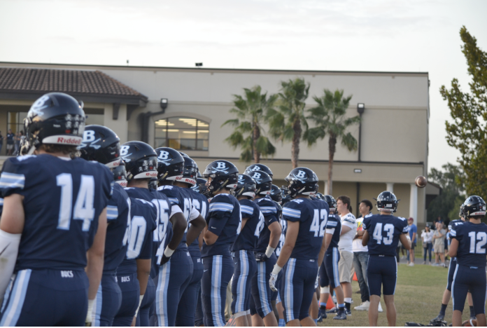 READY TO GO: Berkeley Prep football players size up  opponents before taking the field.