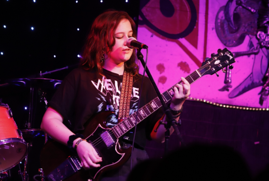 SINGING AND GUITAR SOLOS: In addition to her role in the Mello Divas, Grills '20 sings and plays the guitar in her own band. Photo Credit: Victoria Grills