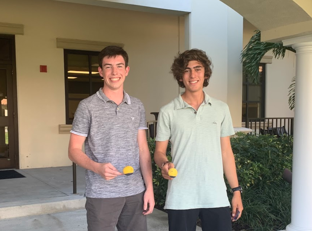 DON'T STOP TIL YOU DROP: Lucas Odom 21' and Adrian Winkelman '21 bond over who can keep a lemon on a spoon for the longest. Photo by Melinda Linsky