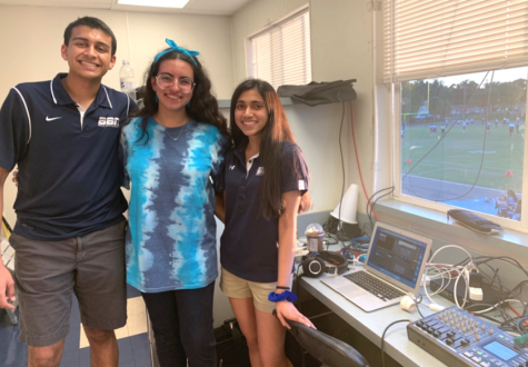 SENIOR SEASON: The Berkeley Broadcast Network's seniors Raj Ghanekar '20, Leana Fraifer '20 and Charvi Sharma '20 (from left) pose for a picture after setting up for the big homecoming game broadcast.