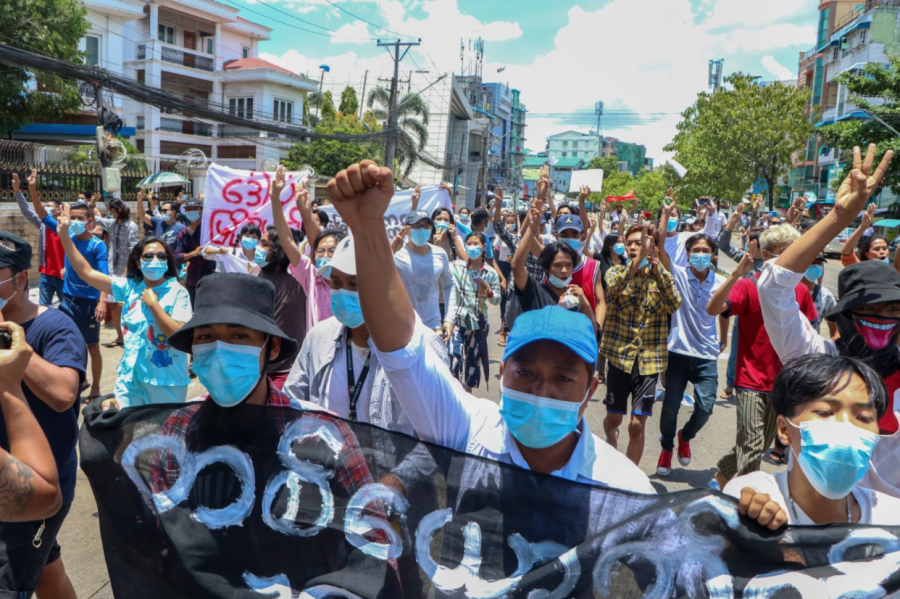 MYANMAR+MADNESS+Anti-coup+protesters+march+during+a+demonstration+in+Yangon%2C+Myanmar+on+Wednesday+May+12%2C+2021.+One+hundred+days+after+their+takeover%2C+Myanmars+ruling+generals+maintain+just+the+pretense+of+control.+The+illusion+is+sustained+mainly+by+its+partially+successful+efforts+to+shut+down+independent+media+and+to+keep+the+streets+clear+of+large+demonstrations+by+employing+lethal+force.+%28AP+Photo%29