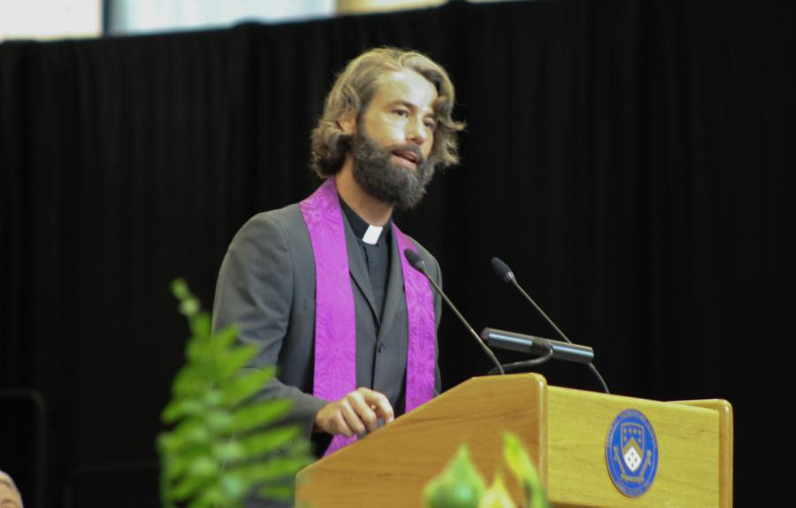 SCHOOL PRAYER: Chaplain Brandon recites the Berkeley school prayer one last time for the seniors.