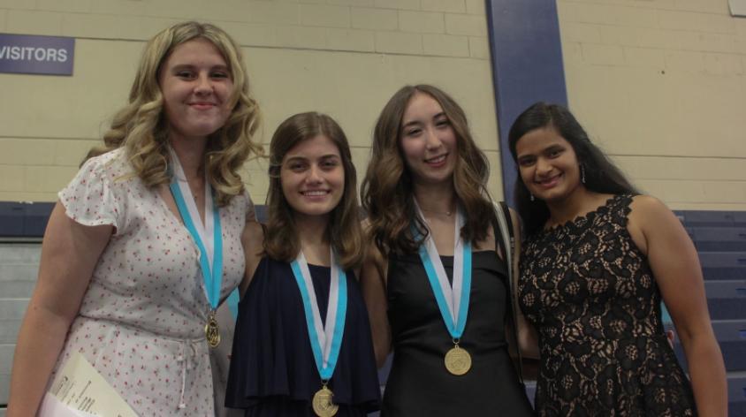 HEADMASTER'S SCHOLARS: Graduating seniors Emma Reilly '21, Sofia Peña '21, Ella Castellano '21, and Sarina Patel '21 (left to right) pose after receiving the Headmaster's Scholar medals.