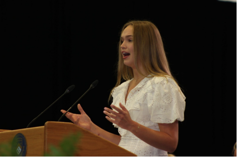 PEACEFUL POET: In her class poem, Emily Bekesh '21 compares the tranquility of nature to the gradual progression of the seniors throughout their four years of high school.