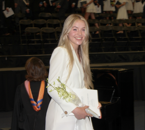 SO LONG: Elle Lawson '21 smiles as she walks off the stage with her diploma in hand.